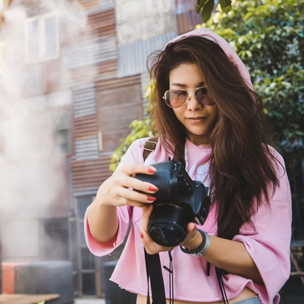 Girl with Camera on hand